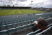 23 April 2017; A spectator reads his programme ahead of the Littlewoods Ireland Camogie League Division 1 Final match between Cork and Kilkenny at Gaelic Grounds in Limerick. Photo by Diarmuid Greene/Sportsfile