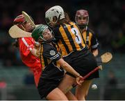 23 April 2017; Katriona Mackey of Cork in action against Catherine Foley, 3, and Michelle Teehan of Kilkenny during the Littlewoods Ireland Camogie League Div 1 Final match between Cork and Kilkenny at Gaelic Grounds, in Limerick.  Photo by Ray McManus/Sportsfile
