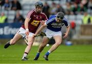 23 April 2017; Aidan Corby of Laois in action against Paul Greville of Westmeath during the Leinster GAA Hurling Senior Championship Qualifier Group Round 1 match between Laois and Westmeath at O'Moore Park, in Portlaoise, Co Laois. Photo by Piaras Ó Mídheach/Sportsfile