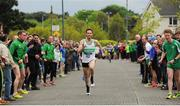 23 April 2017; Conor Dooney, Raheny Shamrock AC, approaches the line to win the Senior Men's relay race. Irish Life Health National Road Relays at Raheny Village, in Dublin. Photo by Tomás Greally/Sportsfile