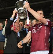 23 April 2017; The President Michael D Higgins with the Galway captain David Burke after the Allianz Hurling League Division 1 Final match between Galway and Tipperary at Gaelic Grounds, in Limerick. Photo by Ray McManus/Sportsfile