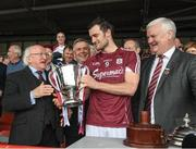23 April 2017; The President Michael D Higgins with the Galway captain David Burke and Uachtarán Chumann Lúthchleas Aogán Ó Fearghail  after the Allianz Hurling League Division 1 Final match between Galway and Tipperary at Gaelic Grounds, in Limerick. Photo by Ray McManus/Sportsfile