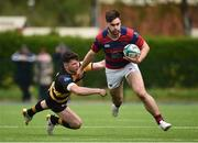 23 April 2017; Conor O'Brien of Clontarf evades the tackle of Calvin Nash of Young Munster during the Ulster Bank League Division 1A semi-final match between Clontarf and Young Munster at Castle Avenue, Clontarf, in Dublin. Photo by Seb Daly/Sportsfile