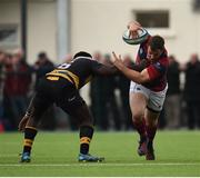23 April 2017; Bryan Byrne of Clontarf is tackled by Elie Mundu of Young Munster during the Ulster Bank League Division 1A semi-final match between Clontarf and Young Munster at Castle Avenue, Clontarf, in Dublin. Photo by Seb Daly/Sportsfile