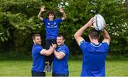 25 April 2017; The Bank of Ireland Leinster Rugby Camps were launched by Leinster Rugby stars Jonathon Sexton, Sean O'Brien and Jack McGrath at a pop up training session in St. Mary's National School, Ranelagh. The camps will run in 27 different venues across the province throughout July and August. Visit www.leinsterrugby.ie/camps for more information. Pictured are Jonathon Sexton of Leinster throws in the ball for a line out to Alex O'Connor lifted by Sean O'Brien, left, and Jack McGrath of Leinster. St. Mary's National School, Milltown Park, Sandford Road, Ranelagh, Dublin. Photo by David Fitzgerald/Sportsfile