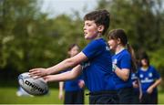 25 April 2017; The Bank of Ireland Leinster Rugby Camps were launched by Leinster Rugby stars Jonathon Sexton, Sean O'Brien and Jack McGrath at a pop up training session in St. Mary's National School, Ranelagh. The camps will run in 27 different venues across the province throughout July and August. Visit www.leinsterrugby.ie/camps for more information. Duinn McGuire in action during a tag rugby session. St. Mary's National School, Milltown Park, Sandford Road, Ranelagh, Dublin. Photo by David Fitzgerald/Sportsfile