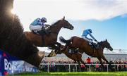 25 April 2017; Un De Sceaux, with Ruby Walsh up, who finished second, jump the last ahead of eventual winner Fox Norton, 2, with Robbie Power up, and God's Own, with Adrian Heskin up, during the BoyleSport Champion Steeplechase at Punchestown Racecourse in Naas, Co. Kildare. Photo by Cody Glenn/Sportsfile