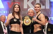 28 April 2017; Katie Taylor, left, and Nina Meinke during the weigh-in at Wembley Arena in London, England. Photo by Lawrence Lustig/Sportsfile