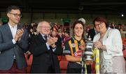 23 April 2017; Michael D Higgins, President of Ireland, and John Goodwin, left, Finance Director, Littlewoods applaud as Catherine Neary, President of the Camogie Association, right, presents the cup to Kilkenny captain Meighan Farrell after the Littlewoods Ireland Camogie League Div 1 Final match between Cork and Kilkenny at Gaelic Grounds, in Limerick.  Photo by Ray McManus/Sportsfile