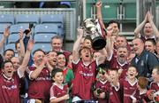 27 October 2011; Galway captain Hector O hEochagain lifts the cup after Dublin selection manager Pat Gilroy, right, had presented it. Alan Kerins Project Charity Match, Galway Selection v Dublin Selection, Croke Park, Dublin. Picture credit: Brian Lawless / SPORTSFILE
