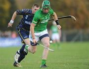 29 October 2011; Joe Bergin, Ireland, in action against Neil McDonald, Scotland. Senior Hurling / Shinty International 2nd Test, Scotland v Ireland, Bught Park, Inverness, Scotland. Picture credit: Barry Cregg / SPORTSFILE