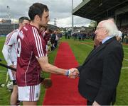 23 April 2017; The President of Ireland, Michael D Higgins, shakes hands with the Galway captain, David Burke, before the Allianz Hurling League Division 1 Final match between Galway and Tipperary at Gaelic Grounds, in Limerick. Photo by Ray McManus/Sportsfile