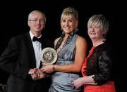 5 November 2011; Waterford's Aisling O'Brien is presented with her 2011 Camogie Soaring Star award by John Treacy, CEO of the Irish Sports Council, Joan O' Flynn, President of the Camogie Association, at the 2011 Camogie All-Stars in association with O'Neills. Citywest Hotel, Saggart, Co. Dublin. Picture credit: Stephen McCarthy / SPORTSFILE