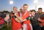 6 November 2011; St. Brigid's players Paddy Andrews, left, and Graham Norton, celebrate with fans after the game. Dublin County Senior Football Championship Final, St Oliver Plunkett's Eoghan Rua v St Brigid's, Parnell Park, Dublin. Picture credit: Paul Mohan / SPORTSFILE