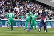 7 May 2017; Ireland players celebrate taking the wicket of Eóin Morgan of England during the One Day International between England and Ireland at Lord's, London, England. Photo by Matt Impey/Sportsfile