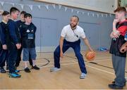 9 May 2017; Swords Thunder basketballer Isaac Westbrooks was in Bluebell Community Centre today at the AIG Heroes event along with pupils from Our Lady of the Wayside School in Bluebell, Dublin. The AIG Heroes initiative is part of the insurance company's community engagement programme and is designed to give support to local communities by leveraging their sporting sponsorships to provide positive role models and build confidence for young people. More information at www.aig.ie. More information at www.aig.ie. Bluebell Community College, Bluebell, Dublin. Photo by Sam Barnes/Sportsfile