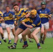19 May 2002; Eamonn Corcoran, Tipperary in action against James O'Connor, Clare. Clare v Tipperary, Munster Senior Hurling Championship, Pairc Ui Chaoimh, Co. Cork. Picture credit; Ray McManus / SPORTSFILE