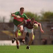 19 May 2002; Shane Moran, Galway, is tackled by Dara Sloyne, Mayo. Galway v Mayo, Connacht Minor Football Championship, Dr. Hyde Park, Roscommon. Picture credit; Brian Lawless / SPORTSFILE