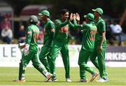 19 May 2017; Sunzamul Islam of Bangladesh, second left, is congratulated by Mosaddek Hossain of Bangladesh after claiming the wicket of Ed Joyce of Ireland during the One Day International match between Ireland and Bangladesh at Malahide Cricket Club in Dublin. Photo by Sam Barnes/Sportsfile