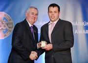 25 November 2011; Referee Christopher Browne, from Galway, is presented with his GAA All-Ireland Hurling Minor B Championship referees' award by Uachtarán CLG Criostóir Ó Cuana. 2011 National Referees' Awards Banquet, Croke Park, Dublin. Picture credit: Barry Cregg / SPORTSFILE