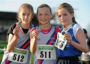 27 November 2011; Jodie McCann, Dundrum South Dublin AC, winner of the Girl's U12 race during the Woodie's DIY Inter County Cross Country Championships with second placed Johanna McCambridge, Dundrum South Dublin AC, left, and third placed Shona O'Brien, Munster, right. Sligo Racecourse, Sligo. Picture credit: Pat Murphy / SPORTSFILE