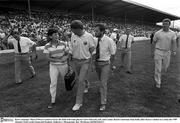 Kerry manager Mick O'Dwyer (centre) leaves the field with team physio Clare Edwards, left, and County Board Chairman Sean Kelly after Kerry's defeat to Corkin the 1989 Munster Final at the Fitzgerald Stadium, Killarney. Photograph: Ray McManus SPORTSFILE.