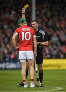21 May 2017; Seamus Harnedy of Cork receives a yellow card from referee James Owens during the Munster GAA Hurling Senior Championship Semi-Final match between Tipperary and Cork at Semple Stadium in Thurles, Co Tipperary. Photo by Brendan Moran/Sportsfile