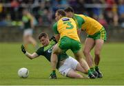20 May 2017; CJ McGourty of Antrim in action against Neil McGee of Donegal during the Ulster GAA Football Senior Championship Quarter-Final match between Donegal and Antrim at MacCumhaill Park in Ballybofey, Co Donegal. Photo by Oliver McVeigh/Sportsfile
