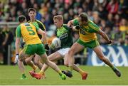 20 May 2017; Peter Healy of Antrim, centre, in action against Michael Murphy of Donegal during the Ulster GAA Football Senior Championship Quarter-Final match between Donegal and Antrim at MacCumhaill Park in Ballybofey, Co Donegal. Photo by Oliver McVeigh/Sportsfile