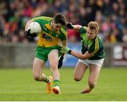 20 May 2017; Ryan McHugh of Donegal  in action against Peter Healy of Antrim during the Ulster GAA Football Senior Championship Quarter-Final match between Donegal and Antrim at MacCumhaill Park in Ballybofey, Co Donegal. Photo by Oliver McVeigh/Sportsfile