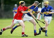 23 May 2006; Jerry McGrath, Cork, in action against Darren O'Meara and Eoin Gleeson, Tipperary. All-Ireland Vocational Schools Hurling Final Replay, Tipperary v Cork, Cashel, Co. Tipperary. Picture credit; John Kelly / SPORTSFILE