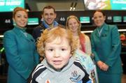 29 November 2011; Aer Lingus announces it will be the official airline partner of Dublin GAA in a three year sponsorship agreement. The GAA All Ireland Football Champions, their manager Pat Gilroy and families were in T2 today, Tuesday 29 November, preparing to fly out to Orlando, Florida, courtesy of Aer Lingus. Pictured is Jamie Brogan, age 2, son of Alan Brogan and his wife Lydia, second from right, with Aer Lingus staff Jamie-Leigh Arthurs, left, and Aine Behan. Dublin Airport, Dublin. Picture credit: Brian Lawless / SPORTSFILE