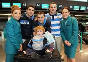 29 November 2011; Aer Lingus announces it will be the official airline partner of Dublin GAA in a three year sponsorship agreement. The GAA All Ireland Football Champions, their manager Pat Gilroy and families were in T2 today, Tuesday 29 November, preparing to fly out to Orlando, Florida, courtesy of Aer Lingus. Pictured are brothers Bernard, Alan and Paul Brogan with Alan's son Jamie Brogan, age 2, and Aer Lingus staff Jamie-Leigh Arthurs, left, and Aine Behan. Dublin Airport, Dublin. Picture credit: Brian Lawless / SPORTSFILE