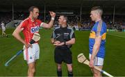 21 May 2017; Tipperary captain Padraic Maher and referee James Owens look on as Cork captain Stephen McDonnell , after winning the toss, indicates the way they will play before  the Munster GAA Hurling Senior Championship Semi-Final match between Tipperary and Cork at Semple Stadium in Thurles, Co Tipperary. Photo by Ray McManus/Sportsfile