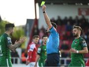 22 May 2017; Referee Robert Hennessy shows the yellow card to Sean Maguire, left, of Cork City during the SSE Airtricity League Premier Division match between Sligo Rovers and Cork City at the Showgrounds in Co. Sligo. Photo by David Maher/Sportsfile