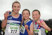 11 December 2011; Caoimhe Harrington, Cork, winner, with second placed Laura Ward, St. Laurence O'Toole AC, left, and third placed Jody McCann, Dundrum South Dublin, AC, right, after the Girl's U13 race at the Woodie's DIY Novice and Juvenile Cross Country Championships. Curragh Camp, The Curragh, Co. Kildare. Picture credit: Pat Murphy / SPORTSFILE