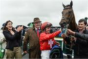 27 May 2017; Jockey Chris Hayes alongside trainer Tom Hogan and Jessica Maguire, daughter of owner Morgan Cahalan after winning the Weatherbys Ireland Greenlands Stakes at Tattersalls Irish Guineas Festival at The Curragh, Co Kildare. Photo by Cody Glenn/Sportsfile
