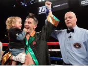 26 May 2017; Michael Conlan celebrates with his daughter Luisne after winning his bout against Alfredo Chanez at the UIC Pavilion in Chicago, USA. Photo by Mikey Williams/Top Rank/Sportsfile