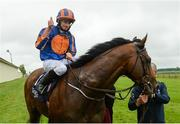 27 May 2017; Ryan Moore celebrates after winning the Tattersalls Irish 2,000 Guineas on Churchill during the Tattersalls Irish Guineas Festival at The Curragh, Co Kildare. Photo by Cody Glenn/Sportsfile