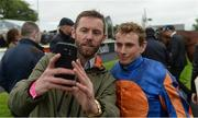 27 May 2017; Jockey Ryan Moore poses with a racegoer after winning the Tattersalls Irish 2,000 Guineas on Churchill during the Tattersalls Irish Guineas Festival at The Curragh, Co Kildare. Photo by Cody Glenn/Sportsfile