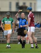 27 May 2017; Shane Dooley of Offaly and Tommy Doyle of Westmeath are both shown the yellow card by referee Seán Cleere during the Leinster GAA Hurling Senior Championship Quarter-Final match between Westmeath and Offaly at TEG Cusack Park in Mullingar, Co Westmeath. Photo by Piaras Ó Mídheach/Sportsfile