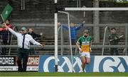 27 May 2017; The umpire raises the green flag after Offaly's fourth goal scored by Shane Dooley, as Stephen Quirke of Offaly looks on during the Leinster GAA Hurling Senior Championship Quarter-Final match between Westmeath and Offaly at TEG Cusack Park in Mullingar, Co Westmeath. Photo by Piaras Ó Mídheach/Sportsfile