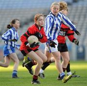13 December 2011; Ann Dalton, St. Colmcille's S.N.S, Knocklyon, in action against Eibhlin Ní Dhuinnshléibhe, Gaelscoil Chnoc Liamna. Allianz Cumann na mBunscol Finals, Corn Irish Rubies, Gaelscoil Chnoc Liamna v St. Colmcille's S.N.S, Knocklyon, Croke Park, Dublin. Picture credit: Brian Lawless / SPORTSFILE