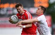 28 May 2017; Enda Lynn of Derry in action against Kieran McGeary of Tyrone during the Ulster GAA Football Senior Championship Quarter-Final match between Derry and Tyrone at Celtic Park in Derry. Photo by Ramsey Cardy/Sportsfile