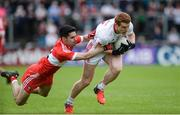 28 May 2017; Peter Harte of Tyrone in action against Niall Keenan of Derry during the Ulster GAA Football Senior Championship Quarter-Final match between Derry and Tyrone at Celtic Park, in Derry.  Photo by Oliver McVeigh/Sportsfile