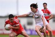 28 May 2017; Danny Heavron of Derry is tackled by Conall McCann of Tyrone during the Ulster GAA Football Senior Championship Quarter-Final match between Derry and Tyrone at Celtic Park in Derry. Photo by Ramsey Cardy/Sportsfile