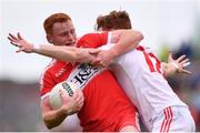 28 May 2017; Conor McAtamney of Derry is tackled by Conor Meyler of Tyrone during the Ulster GAA Football Senior Championship Quarter-Final match between Derry and Tyrone at Celtic Park in Derry. Photo by Ramsey Cardy/Sportsfile