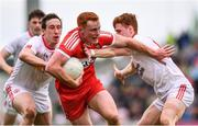 28 May 2017; Conor McAtamney of Derry is tackled by Colm Cavanagh, left, and Conor Meyler of Tyrone during the Ulster GAA Football Senior Championship Quarter-Final match between Derry and Tyrone at Celtic Park in Derry. Photo by Ramsey Cardy/Sportsfile
