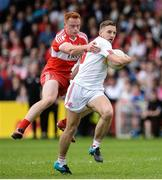 28 May 2017; Niall Sludden of Tyrone  in action against Conor McAtamney of Derry  during the Ulster GAA Football Senior Championship Quarter-Final match between Derry and Tyrone at Celtic Park, in Derry.  Photo by Oliver McVeigh/Sportsfile