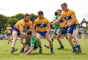 28 May 2017; Seamus O'Carroll of Limerick in action against, from left, John Hayes, Martin McMahon, and Pearse Lillis of Clare during the Munster GAA Football Senior Championship Quarter-Final between Clare and Limerick at Cusack Park in Ennis, Co. Clare. Photo by Diarmuid Greene/Sportsfile